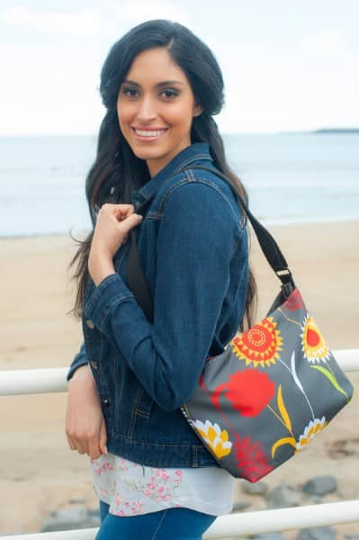 Grey Meadow Fely Bag being worn over the shoulder